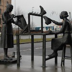 Kvinnor vid gummifabriken